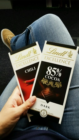 lindt: Hand holding two chocolate bars