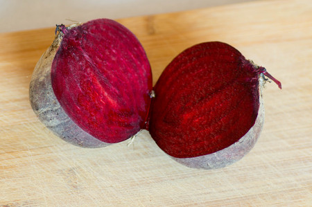 foodies: Sliced beetroot with wooden board background Stock Photo