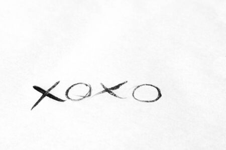 xoxo: Handwritten xoxo message with black ink on white paper