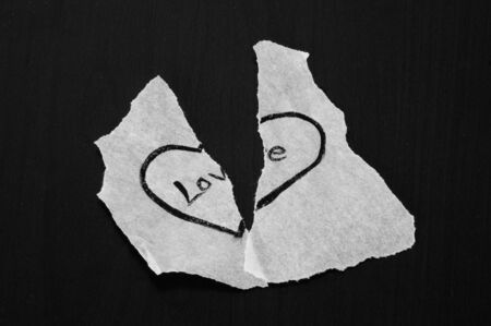 halved: Torn piece of paper with heart illustration and love message