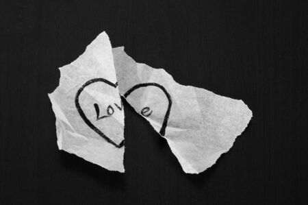torn heart: Crumpled torn piece of white paper with love message in black and white
