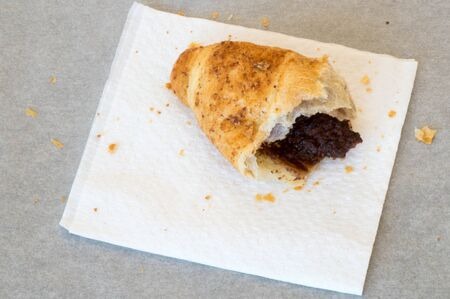 white napkin: Top view of a half croissant on a white napkin