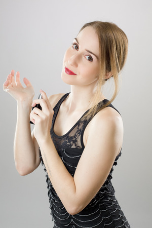 Beautiful woman with bottle of perfume Banco de Imagens