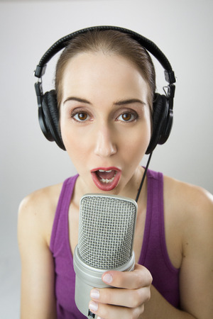 micro recording: Woman singing Into Microphone