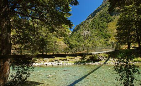 tramping: Swingbridge over the river, New Zealand Stock Photo