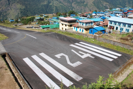 off track: Lukla airport (village in the Khumbu area of the Solukhumbu District in the Sagarmatha Zone of north-eastern Nepal) Stock Photo