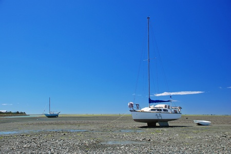 Boat on low tide Stock Photo - 13752953