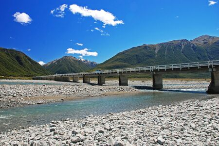 Bridge over the river Waimakariri, Arthurs Pass national park, New Zealand Stock Photo - 13753090