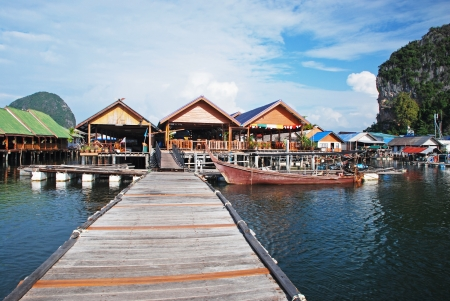 fishing huts: Fishing village on water, Thailand Stock Photo