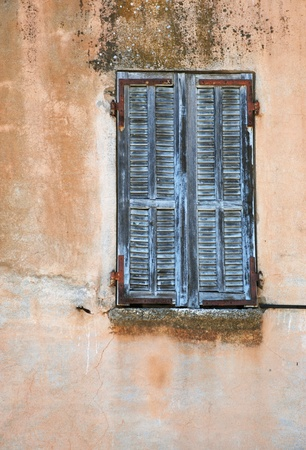Detail of an old window, Corsica, France photo