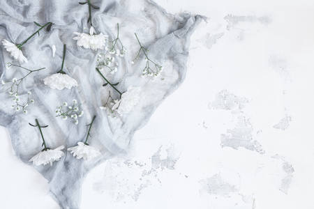Composition with white flowers on gray background. Flat lay, top view Stock Photo