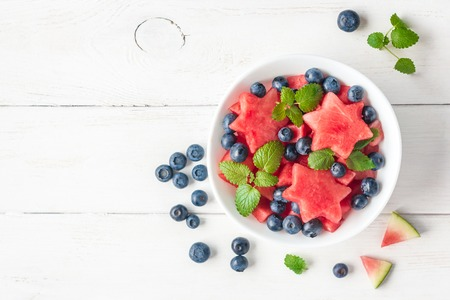 Summer fruit salad of watermelon and blueberries, top view, flat lay