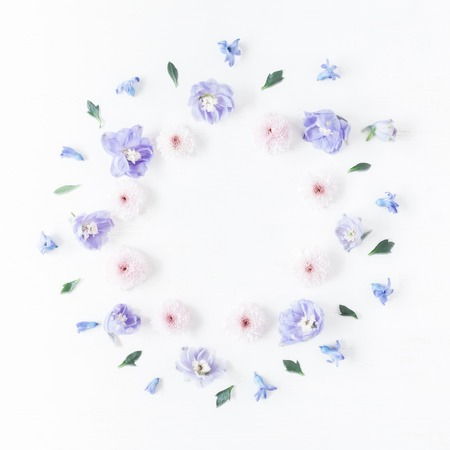 blue petals: Frame made of lilac and pink flowers. Flat lay, top view