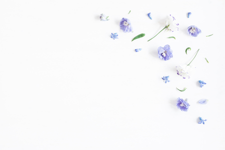 Flowers composition. Border made of lilac and white flowers. Flat lay, top view