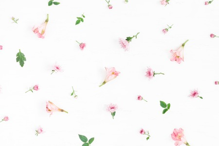 white: Flowers composition. Pattern made of pink flowers on white background. Flat lay, top view
