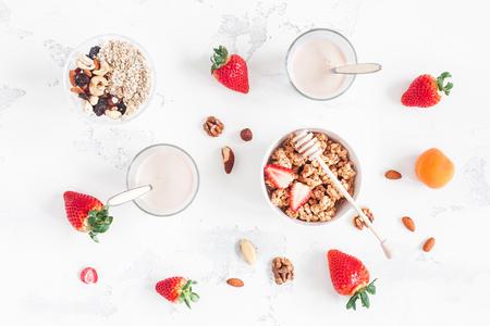 Healthy breakfast with muesli, yogurt, strawberry, nuts on white background. Flat lay, top view 版權商用圖片 - 71872249
