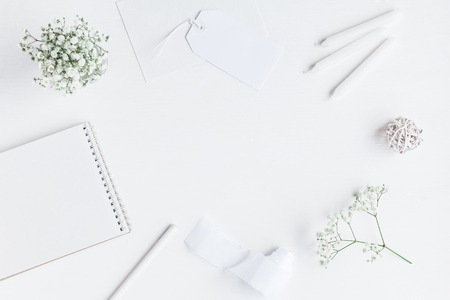 Workspace with notebook, paper blank, gypsophila flowers, pencils. Wedding concept. Flat lay, top view Stock fotó - 73191339