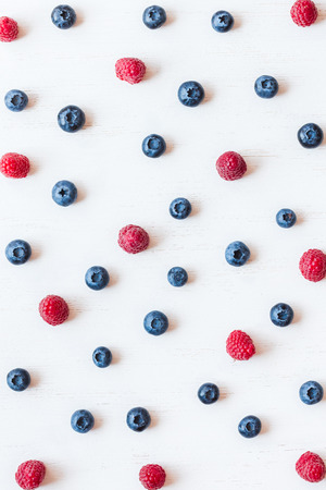 pattern of blueberry and raspberry, top view, flat lay Фото со стока