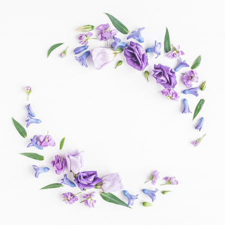 Flowers composition. Wreath made of various colorful flowers on white background. Flat lay, top view
