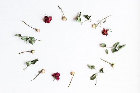 Frame made of dry rose flowers. Top view, flat lay