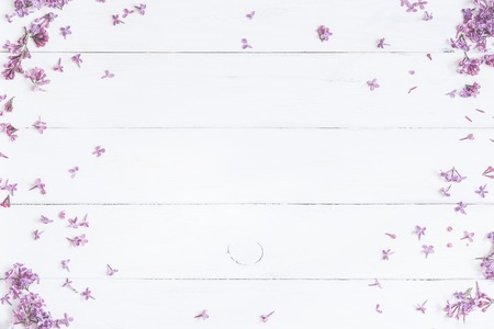 Spring flowers . Lilac flowers on white wooden background. Top view, flat lay Archivio Fotografico