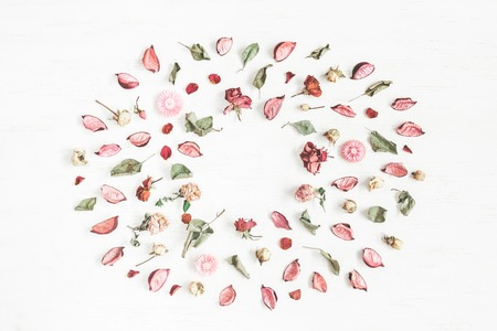 Flowers composition. Frame made of dried flowers and leaves. Top view, flat lay Stock Photo