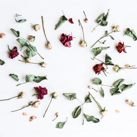 Frame made of dried rose flowers. Top view, flat lay Stock Photo