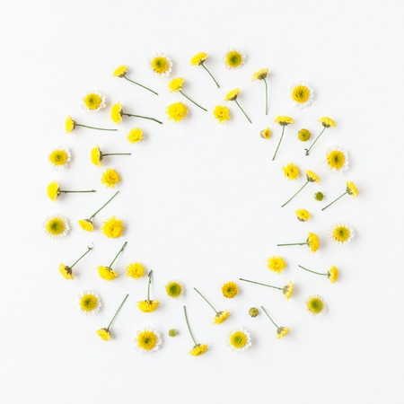 Flowers composition. Wreath made of various yellow flowers on white background. Easter, spring, summer concept. Flat lay, top view Zdjęcie Seryjne - 74780247