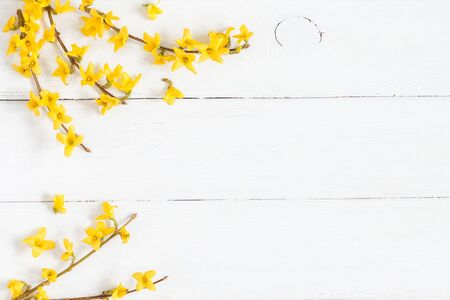 Flowers composition. Frame made of yellow flowers on wooden white background. Easter, spring, summer concept. Flat lay, top view Stock fotó - 74780257