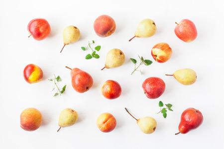 Fruit on white background. Pears, apples, peaches, nectarines. Fruit pattern. Flat lay, top view