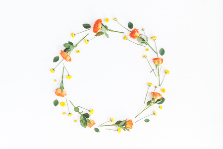Flowers composition. Wreath made of orange and yellow flowers on white background. Flat lay, top view