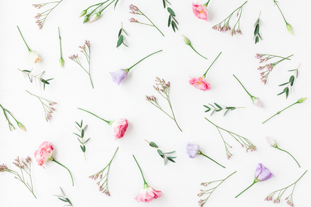 Flowers composition. Pattern made of various flowers and eucalyptus branches on white background. Flat lay, top view Stock fotó