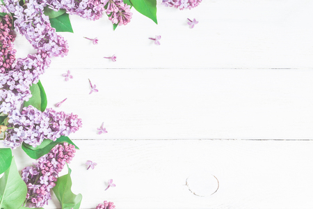 Spring flowers. Lilac flowers on white wooden background. Top view, flat lay