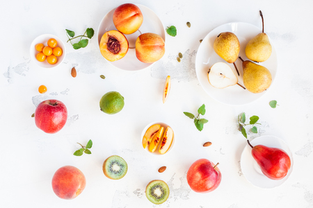 Fresh fruits on white background. Summer fruits. Flat lay, top view