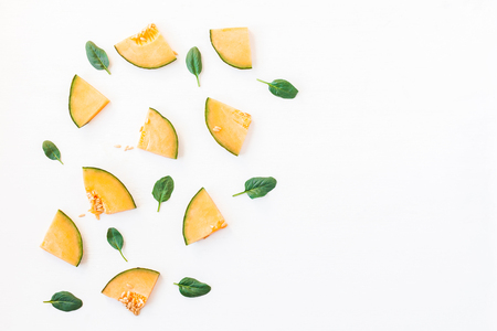 Sliced melon on white background. Flat lay, top view Stock Photo