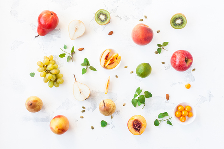 Fresh fruits on white background. Fruit pattern. Flat lay, top view