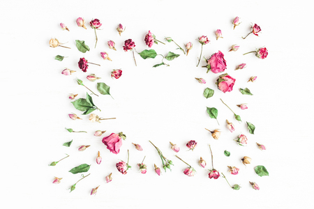 Flowers composition. Frame made of dried rose flowers. Flat lay, top view Stock Photo
