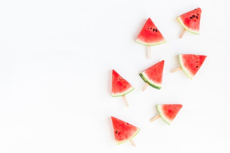 sliced watermelon: Sliced watermelon on white background. Flat lay, top view