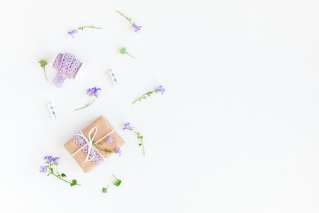 Flowers composition. Gift and bell flowers on white background. Flat lay, top view