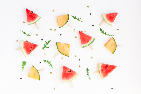 Watermelon popsicle and melon popsicle on white background. Top view, flat lay Stock fotó