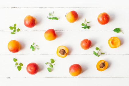 Apricot on white wooden background. Sliced apricot top view, flat lay Reklamní fotografie