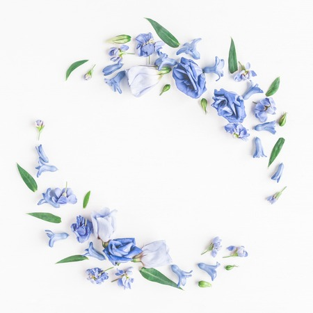 Flowers composition. Wreath made of blue flowers on white background. Flat lay, top view