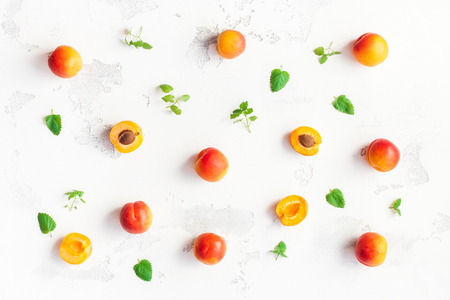 Apricot on white wooden background. Sliced apricot top view, flat lay Stock Photo