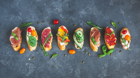 Traditional spanish tapas on black background. Flat lay, top view Banque d'images