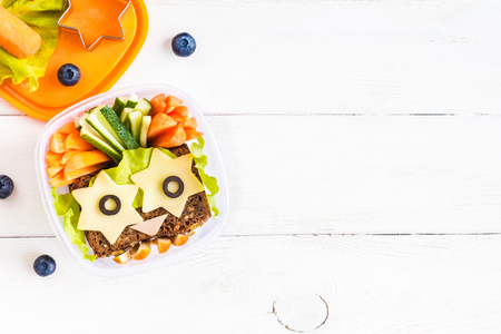 smiley: School lunch box for kids. Top view, flat lay