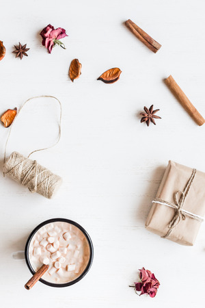Autumn. Hot chocolate, knitted blanket, gift, dried flowers and autumn leaves. Flat lay, top view Stock Photo