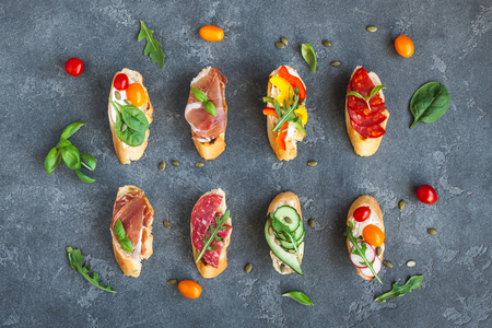Traditional spanish tapas on dark background. Flat lay, top view Stock fotó - 84997571