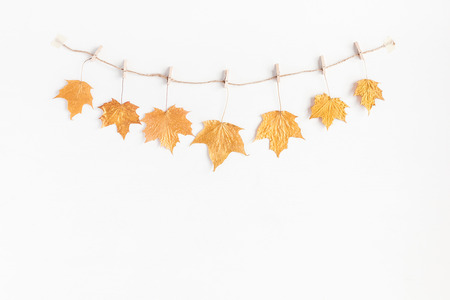 Autumn composition. Autumn maple tree leaves on white background. Flat lay, top view, copy space