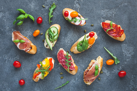 Traditional spanish tapas on dark background. Flat lay, top view Stockfoto