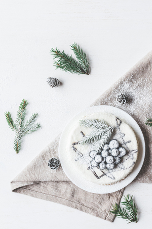 Christmas composition. Blueberry cake with fir branches, Christmas dessert. Flat lay, top view Фото со стока